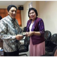 The Meeting between the Dean of Faculty of Arts Unud and the Vice Rector I University of Indonesia after Examination of the Dissertation Proposal